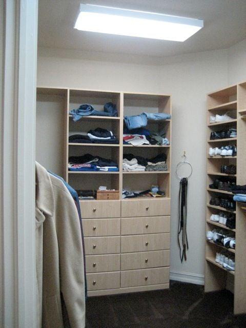 """BEFORE"" His master bedroom closet."